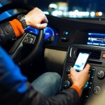 Using Your Cell Phone While Driving – What Will It Cost You?